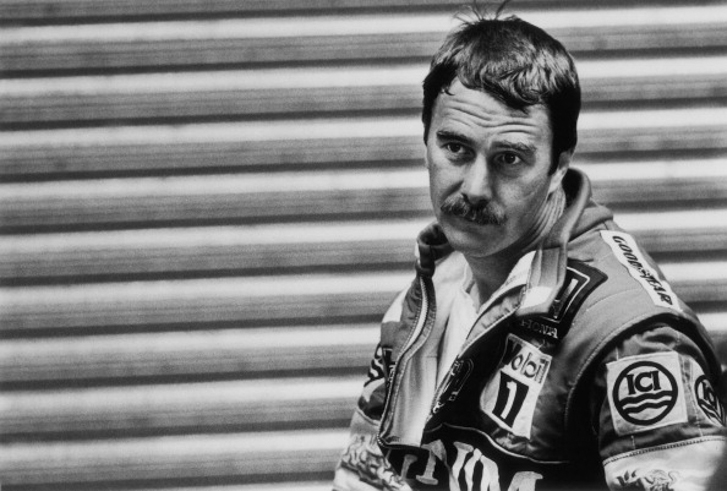 Formula One Grand Prix racing driver Nigel Mansell, driving for Williams-Honda, pauses in the teams pit lane garage after a qualifying session ahead of the 1987 British Grand Prix at the Siverstone Circuit, near Towcester, Northamptonshire, U.K, on Friday, July 10, 1987. Mansells secured victory at Siverstone by beating his Williams-Honda team-mate Nelson Piquet. (Photo by Bryn Colton/Getty Images)