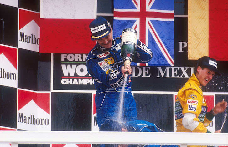 1992 Mexican Grand Prix. Mexico City, Mexico. 20-22 March 1992. Nigel Mansell, 1st position gives Riccardo Patrese 2nd position (both Williams Renault) a showering of champagne on the podium. Behind is Michael Schumacher (Benetton Ford) 3rd position. Ref-92 MEX 06. World Copyright - LAT Photographic
